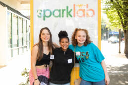 Youth pose with SparkLab sign